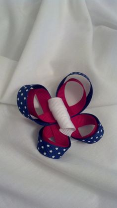 2 inch clip covered in a grosgrain ribbon with a ribbon butterfly on top  Fourth of July  July 4th  Carlykins Boutique Baby Girl Hair Accessories by CarlykinsBoutique, $4.25