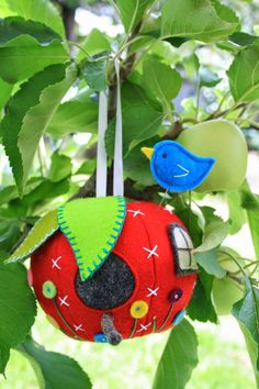 adorable! hanging birdhouse pincushion, from the vintage ric rac blog