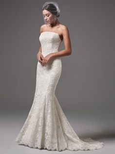 Sottero and Midgley - LINLEY, This modern and sophisticated strapless fit-and-flare features floral lace motifs and a chic straight neckline. Finished with covered buttons over zipper and inner corset closure.