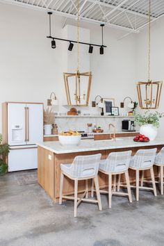 office reveal + interior design firm office + kitchen in the workplace + large pendants over island Concrete Kitchen, Kitchen Flooring, Kitchen Decor, Kitchen Design, Kitchen Interior, Kitchen Island With Sink, Black Kitchen Faucets, Natural Kitchen, White Appliances