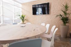 Meeting room featuring a large recycled Cypress table