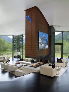 2. This fireplace in a renovated home in Aspen, Colorado, divides the space between the two levels.