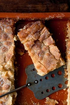 NYT Cooking: Legend has it that the St. Louis gooey butter cake originated by accident in the 1930s, when a baker mixed up the proportion of butter in one of his coffee cakes. Rather than throw it out, he sold it by the square, and the sugary, sticky confection was a hit. Naturally, a slice of gooey cake ends up next to � or in place of � the pumpkin pie at many a%2...