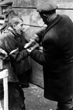 Warsaw, Poland, A child caught while attempting to smuggle, 1940-1943. All captured child smugglers were murdered by Nazi bastards. Their crime was smuggling food into the ghetto because they were being starved by said bastards.