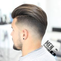 Medium fade with slick back on top More