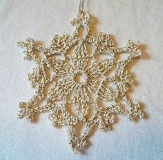 Crocheted Snowflake Ornament by tabachin on Etsy, $4.75