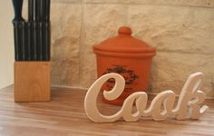 Wooden sign in the kitchen