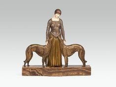 "Elfenbein, geschnitzt; Bronze, gegossen, kaltbemalt, z. T. vergoldet; Onyx; seitlich auf dem Sockel signiert: ""Chiparus"", rückseitig am Kleidsaum gemarkt ""10"" H. 63 cm; B. 65 cm (inkl. Plinthe) Schätzpreis: 40000 - 70000 € Modern Art, Contemporary Art, Friends Forever, Bronze, 19th Century, Art Nouveau, Bookends, Auction, It Cast"