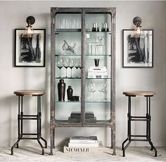 RH's Circa 1900s Steel & Glass Surgeon's Cabinet:An early 20th-century medical-supplies cabinet informed the crisp lines of our steel shelving. Fitted with clear glass on all sides, it offers an unobstructed view. An antiqued metal frame lends it the patina of age.