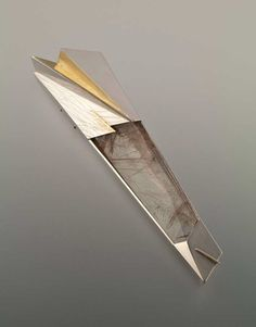 """Icicle"" brooch by Eleanor Moty, 1989. Sterling silver, 22K gold, rutilated quartz."