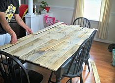 pallet kitchen table just cover existing table with pallet wood. Great idea.