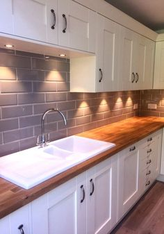 Image result for cream cabinets, brick tiles, wood worktop