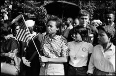 A crowd at the funeral for one of the four girls killed in the KKK bombing of the 16th Street Baptist Church. Birmingham, Alabama, 1963.  By Danny Lyon
