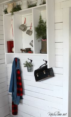 A CHRISTMAS ENTRYWAY decorated with lots of vintage pieces and greenery is a beautiful way to welcome family and friends into your home for Christmas!