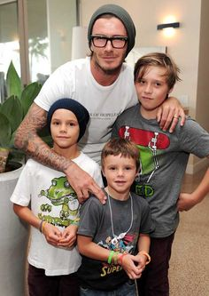 Becks with Brooklyn, 12, Romeo, 8 and Cruz, 6. Harper's going to be well looked after with 3 older brothers.