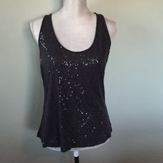 NY&Co sequin tank Very comfy and soft black sequin tank. T-shirt material feel with stylish look! New York & Company Tops Tank Tops