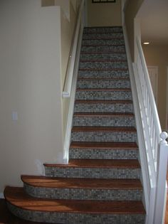 OMGosh! I am sooo doing this in my new house. Stairs are the first thing you see when enter the front door.
