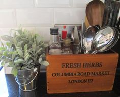 I love using wooden boxes to store things. I love the texture and richness of the wooden grain - I also love Columbia Rd Market, so this has happy memories. Oils, pepper and utensils are close at hand for cooking. Click to visit our website and subscribe to our blog. Photo styled by Eden Home Solutions