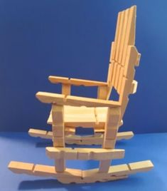 This cute miniature rocking chair is so easy to make, and it's fully functional. All you need are a few clothespins and wood glue. This is perfect for holding dolls, stuffed animals, or gift giving!
