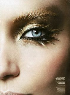 Gold and black lashes and eye makeup great for Hermia or Fairy Queen