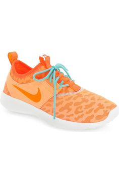 These bold sneakers by Nike will definitely jazz up the daily work out. Orange and blue make these fun kicks standout.