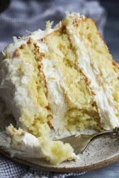 The Very Best Coconut Cake Recipe EVER Fluffy soft with the perfect amount of coconut flavor topped with creamy coconut buttercream frosting cookiesandcups coconutcake cakerecipe cake buttercream coconutfrosting Best Cake Recipes, Cupcake Recipes, Sweet Recipes, Gourmet Cupcakes, Frosting Recipes, Easy Recipes, Cupcake Cakes, Coconut Recipes, Baking Recipes