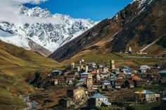 Svanetian Towers in Ushguli in autumn. One of the highest inhabited village in Europe. Caucasus, Upper Svaneti, Georgia. Ancient Ancient Architecture Architecture Beauty In Nature Building Exterior Georgia Glacier High Angle View Landscape_Collection Medieval Mountain Mountain Range Mountain View Mountains And Sky No People Outdoors Snow Towers Travel Destinations Ushguli Village Miles Away