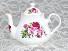 Bone China Teapot in the classic Summertime Rose pattern featuring bold red and pink roses.  4 Cup Capacity