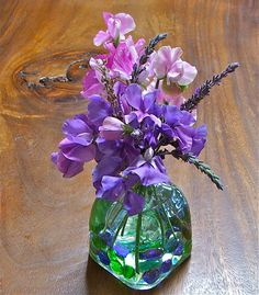 centerpiece heirloom purple sweet peas and lavender in patron vase