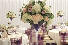 ivory blush and purple wedding flowers centrepieces, Martini vase centrepieces…