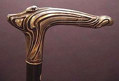 Cane with Art Nouveau silver handle with stylized stork with sapphire eyes. Wood painted shaft. France