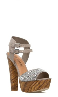ThisLEILA STONEsandal is earthy but elegant. Naomi's wood-effect platform offsets a sparkling stone-covered strap.