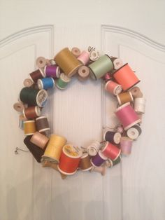 Glue old thread spools on a grapevine wreath and fill in small spots with wood spools from the craft store. Love the way it turned out!