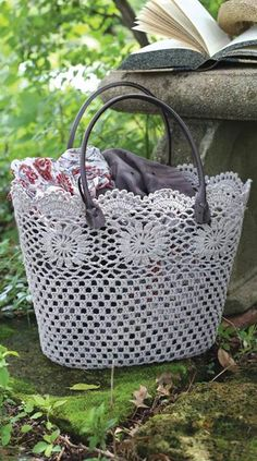 A hand-crocheted lace tote bag affords breathing room for all your necessities.