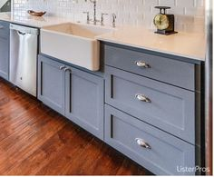Large farm sink with bridge faucet, large bank of drawers and dw on window wall (dw may be to right of sink). Love the large drawers with farm sink together!