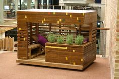 DEAK designed cubby house, created from recycled basketball court floor boards.