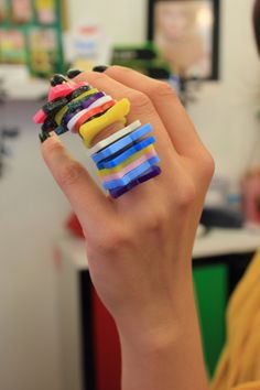 Tatty Devine customer Liza tries on all our rings at once!