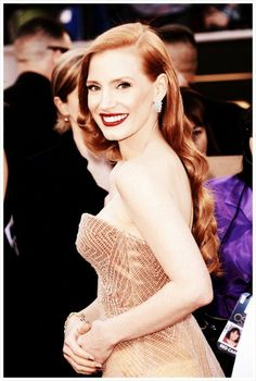 Jessica Chastain .... not sure that I like the fit of the dress from this angle