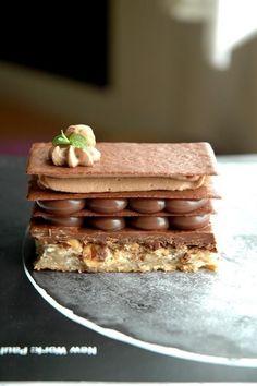 Chocolate Hazelnut Napoleon (Hazelnut Dacquoise, Praline, Milk Chocolate Orange Ganache, Chocolate Tuile Sheet, Milk Chocolate Cardamom Whipped Cream & Whole Caramelized Hazelnut)