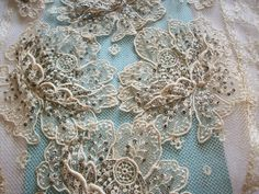 """41 1/2"""" long x 10 1/2"""" wide piece of antique lace with loads of tiny real metal silver sequins. The roses have been appliqued on top giving it its' 3-dimensional effect. -- amazing vintage trim."""