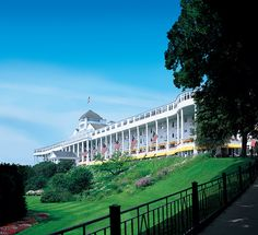 Enjoy a relaxing afternoon in #puremichigan on the front lawn of @Grand Hotel playing games or reading a book