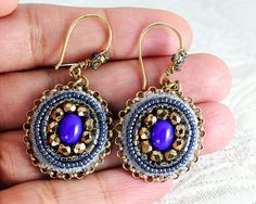 Blue and gold embroidered earrings.