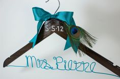 Peacock themed Wedding / Bridal Hanger! A unique way to incorporate your wedding theme into your wedding dress hanger.