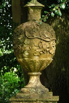 Lovely old garden urn. This looks straight out of Merry Hall (by Beverly Nichols).