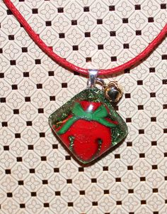 Holiday bell in resin accented with real mini bell pendant