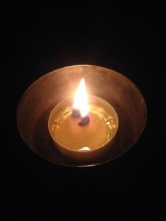 Long lasting candle from cotton ball and olive oil.