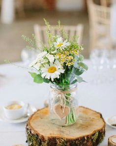 Wedding Themes A simple daisy wedding centerpiece.Your wedding florals do not need to be complicated. These are some favorite simple wedding florals using greenery that look elegant, no one need know you spent less on wedding flower arrangements. Daisy Wedding Centerpieces, Daisy Decorations, Wildflower Centerpieces, Wedding Themes, Wedding Flower Decorations, Wedding Colors, Flowers Decoration, Ceremony Decorations, Wedding Dresses