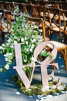 Wooden love signage... great idea to use as part of centerpiece