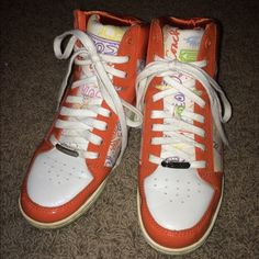 Authentic Coach high top sneakers- size 8 Authentic Coach high top sneakers - size 8- pre owned- shows wear on bottoms and on spots of exterior- the rubber around the bottom edges could also use a cleaning- still cute shoes Coach Shoes