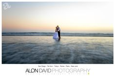 Love this image, It is done with low shutter speed to get the water softer.  It was a bit hard to make happen being that the camera is in the water with a Tripod and the Bride and the Groom can't move for about 3 sec  www.AlonDavidPhotography.com